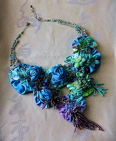 Carla S. Fox is an american designer of beautiful vintage jewelry. In her work she uses fabric scraps, samples and yardage, the antique and vintage buttons, jewelry bits and pieces, lace, textiles, found objects, feathers, leaves and millinery veiling