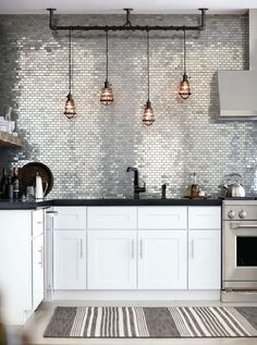mirrored subway tiles in the kitchen, genius!