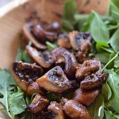 Roasted garlic mushroom salad over arugula with wild rice, goat cheese and lemon. It's the bomb dot com. #EatSeasonal