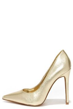 "From ballroom to birthday bash, the Click Your Heels Gold Pointed Pumps put the flash in your dance! Metallic gold vegan leather sculpts a flashy pointed-toe upper, with a 4.75"" stiletto heel (including tip) on a single sole. Padded insole. Rubber sole has nonskid markings. Available in whole and half sizes. Measurements are for a size 6. All vegan friendly, man made materials. Imported."