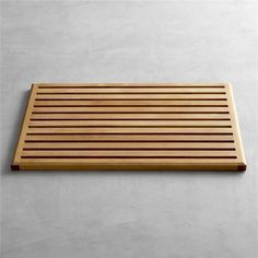 "Teak Doormat, really want for outside, ""hose your feet off"" area near yard entrance"