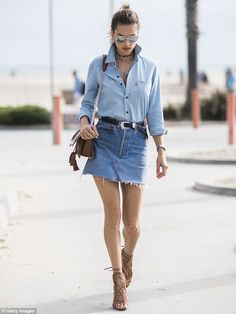 Street style: Alessandra Ambrosio flaunted her million dollar assets in a short jean skirt and sky-high stilettos as she stepped out in Los Angeles on Monday