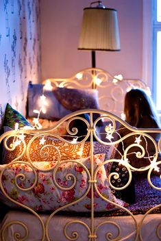 Metal bed and fairy lights, and cushions...