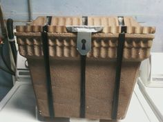 """Frugal treasure chest, great for a pirate themed party or VBS.  All you need is: 1 styrofoam cooler,1 can brown spray paint, a little duct tape & black electrical tape from your tool box to make """"hinges"""", """"lock"""" & bands, a scrap of cardstock to make the lock, black permanent marker to draw on keyhole and screws in the hinges. Wonder if this could work as a piñata too?"""