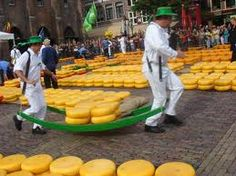 In Alkmaar, there is the Kaas Markt (Cheese Market) where the sale of cheese is being bidded upon.  It's like Wall Street for CHEESE!  More cheese in one place than I've ever seen before.  The girls walk around in traditional garb including wooden shoes!  OUCH!