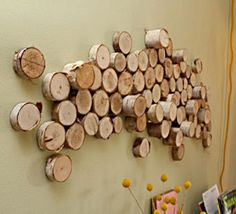 I like the idea of using tree stumps from the property to create this.  It could be cool on a wall behind a toilet.