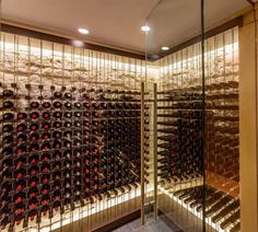 -LEFT: Today's wine cellars don't have to have an Old World rustic design. Many are taking a modern turn into the 21st century, as is this Boston home's wine cellar with limestone walls and a stainless steel-constructed grid to hold bottles.