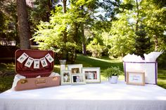 Card and gift table with photos from the groom's parents' wedding, the bride's parents' wedding,