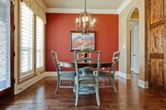 Decoration, Classy Old Wooden Dining Chairs With Round Pedestal Dining Table On Wood Floors As Well As Large Open View Windowed In Red Dining Room Decor Tips: Stunning Red Dining Room From Furnitures, Wall Colors And Decorations