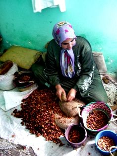 A Woman Making Argan Oil. Argan oil is an all natural oil coming from the argan tree in Morocco, which has been used and produced by the Berber women there for centuries. Marocco