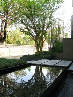 Classic Contemporary steel water feature & concrete pavers. Most of all, I love the tree silhouette & water reflection.