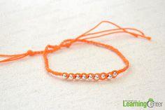Finish braiding beads into bracelet