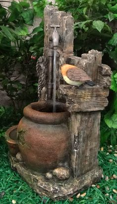 Water tap with jar and bird water feature by Velda.