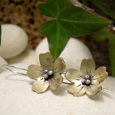 Mixed metal dangle earrings featuring a rustic golden plum blossom flower with sterling silver detail, on sterling silver ear wire. Organically boho for