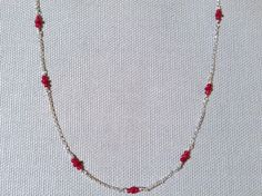Edgy, rock and roll meets feminine and dainty from Indiana Jewelry Artist, Evan Knox. Handmade Silver Necklace with ruby, ruby jade, silver layer