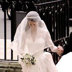 Catherine Middleton holding onto her father's hand as they enter Westminster Abbey. When she leaves the abbey Kate Middleton will be Catherine, Duchess of Cambridge.♕