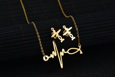 DIDa Heartbeat Necklace Stud Earrings Set StainlessSteel Jewelry Set for Women Gold >>> Find out more reviews of the product by checking out the link on the photo. (This is an affiliate link). Heartbeat, Earring Set, Jewelry Sets, Arrow Necklace, Stud Earrings, Link, Gold, Women, Stud Earring