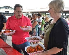 Hundreds ate creole food, danced and listened to Cajun music at the City Market Crawfish festival, a mid-summer Mardi Gras party Friday, Aug. 8, 2014. Anthony and Sharon Manzella of Lee's Summit had their hands full with creole food. The line seemed to be hundreds of people long.