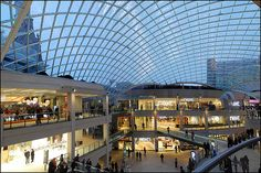 https://flic.kr/p/e5UMaB | Trinity centre, Leeds | A 4 shot horizontal and vertical stitch. A 3,716 m2 (40,000 sq ft) glass dome is the centrepiece of Trinity East. Designed by SKM Anthony Hunts, its 1902 glass panels rise 30.5 m (100 ft) above street level. The dome is built on a steel framework, and during construction was supported on an immense scaffold structure, which when removed in early 2012 resulted in the dome sinking 20mm. The dome is large enough to fit the Corn Exchange under…