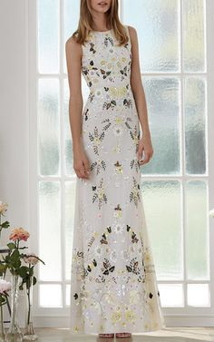 This sleeveless **Needle & Thread** dress features allover floral sequin embroidery, a jewel neckline with a fitted bodice, and a floor length fit and flare skirt.