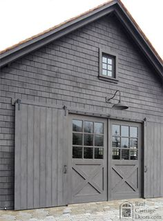 Love the monochrome, the doors, the barn light. Modern Barn, Modern Farmhouse, Farmhouse Front, Carriage Doors, Carriage House, Barn Garage, Barn Living, House Colors, Exterior Design