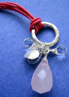 a simple necklace of rutilated quartz and a Karen Hill Tribe flower pendant…