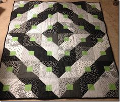 beginner, beginner quilt, beginner quilting, black and white quilt, backing fabric, batting, contemporary, cotton, Fabric, log cabin, machine quilt, modified log cabin, paradigm shift, pinning, quilt, quilting, quilting tutorial, square blocks, tutorial