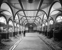 Buckingham Palace Stables. The Gothic arches give the space a moody and dramatic feel.