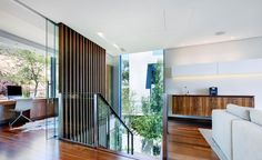 Architecture, Charming Open Plan Second Floor In Modern Home Designing With Wall Mount Retro Console Table And Wood Laminate Floor Plus Glass Balustrade For Staircase As Well As Workspace Also Side Chair Leather Rug: Stylish Home Designing Created in a Futuristic Style