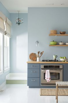 A soft, sophisticated blue-grey works well in cool schemes teamed with crisp white and plenty of natural light. This colour scheme is ideal for that classic, fresh beach look, and perfect for your kitchen. Get more paint colour ideas and inspiration at housebeautiful.co.uk