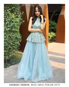Turq blue halter neck peplum top with matching organza skirt only on KalkiYou can find Designer dresses indi. Sharara Designs, Choli Designs, Lehenga Designs, Indian Gowns Dresses, Indian Fashion Dresses, Dress Indian Style, Indian Designer Outfits, Pakistani Party Wear Dresses, Pakistani Dresses Online