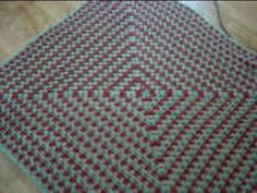 This is one of the most fastest and easiest ways to create a blanket. Using 3 colours to create a spiraling effect. It is my favourite. My website is http://thecrochetcrowd.com. Free written pattern is available at http://thecrochetcrowd.com/rainbow-never-ending-granny-squares.html