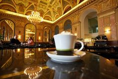 BookCafe, Alexandra Books in Budapest, Hungary. Best cafe ever. Set in an old ballroom so stunning but also pretty cheap.