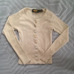 Free People Sweater This vintage free people sweater is so soft and cool. Has amazing buttons! Is a medium but fits like a small. Soooooo comfortable Free People Sweaters