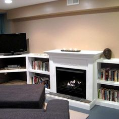 Love the use of half-sized bookshelves. Doesn't overwhelm the room, yet provides great storage.