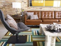 A bold rug is a great way to add a lot of pattern to a large, and often overlooked, area of your living room — the floor. If you're concerned that a bold pattern is something you'll tire of quickly or if your home is filled with pets and kids and you're worried about the wear and tear, try replaceable carpet tiles instead of a single large rug.