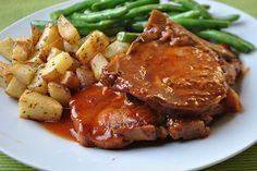These slow cooker BBQ pork chops slow cook in your favorite BBQ sauce for 3 hours and come out falling off the bone and juicy.
