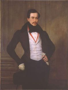 Portrait of Eugene Deveria Meffre-Rouzan, 1833 by Eugene Deveria (1805-1865) - red ribbon - white kid gloves...Meffre-Rouzan (1809-1889) is presented as the very model of a dashing Creole gentleman. Born in New Orleans to recent French émigrés, Julien was educated in Paris. He enjoyed gambling and was an avid collector of paintings and sculpture, commissioning this portrait in Paris when he was 22 years old.
