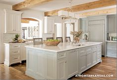 White cabinets mixed with those with a hint of blue were used in the kitchen.