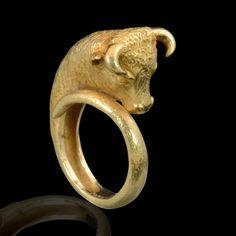 Greek revival Striking ring designed as the head of a taurus, Mauboussin, Paris, c1960sMakerMauboussin, ParisPeriodcirca 1960sOriginParis, France