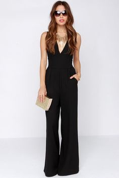 There's no wrong way to wear a jumpsuit, especially when it's the BB Dakota Robbie Black Jumpsuit! This woven poly jumpsuit can work for lots of different occasions thanks to the sleeveless deep V bodice, and a split back with a large open cutout. Two front pockets add functionality below the waist, and wide legs give a roomy feel to the pants. Hidden back zipper/clasp. Unlined. 100% Polyester. Hand Wash Cold. Imported.