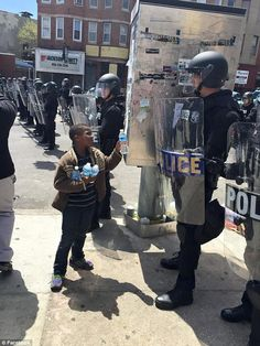 Photo shows little boy handing water to riot police in Baltimore Baltimore Riots, Baltimore Police, Baltimore Maryland, We Are The World, In This World, Sara Fabel, Riot Police, Police Officer, Police Jokes