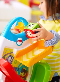 The Fisher-Price Roller Blocks Play Wall features two sides of interactive play with innovative blocks that stack, drop, roll and tumble – keeping babies and toddlers active during playtime.