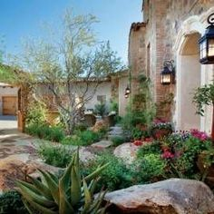 This Italian-Style desert garden includes an entry courtyard designed to have a lush, welcoming feel with layers of plants to stimulate the eye.