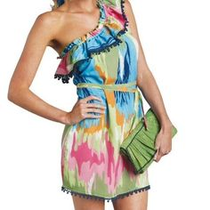 """NWT Mudpie Watercolor One Shoulder Dress New with tags Mudpie watercolor one shoulder dress. Size Large. Decorative trim around ruffle color and hem. 40"""" bust, 40"""" waist, 45"""" hips, underarm to hem 28"""". Tie waist belt is missing. No trades, offers welcome. Mudpie Dresses One Shoulder"""