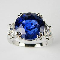 8 carat round, unheated, gem quality, Burma Sapphire with D, Flawless half moon diamond sides set in platinum.