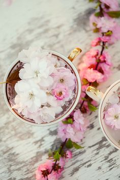 flowers with hints of pink peeking from teacups