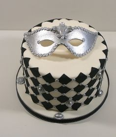 Venetian mask cake  by elizabethscakeemporium, via Flickr