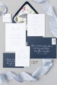 "This delicate indigo stationery suite was created around a beautiful hand-drawn laurel by Andrea Stimson of Fig & Flourish Calligraphy. It is no surprise that her flowing hand shows up on the envelopes as well! Envelopes are lined with ""Herb Garden"" by Rifle Paper Co., a gorgeous accent to the navy script. Design by Becca Mercer / Photo cred: www.samikathryn.com #navywedding #weddinginvitationsuite #weddinginvitation #laurel #illustration #silkribbon"