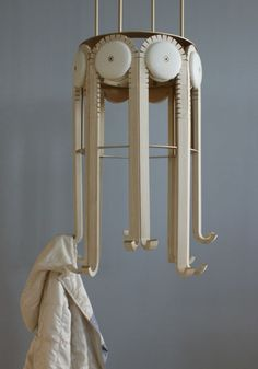 Mechanical Coat Rack Moves When A Jacket Is Removed -- really cool idea.